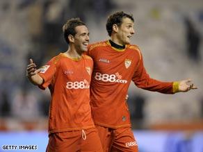 Fernando Navarro (left) and Sebastien Squillaci celebrate Sevilla's superb win at Deportivo on Saturday.