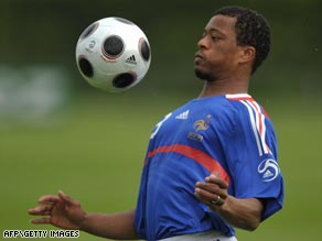 France defender Patrice Evra will be out for a minimum of three weeks after hurting ankle ligaments.