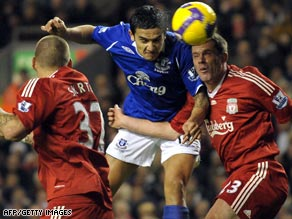 Tim Cahill earned Everton the point they deserved with a header three minutes from the end to deny Liverpool.