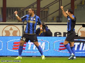 Adriano (left) celebrates his opening goal as Inter reached the Coppa Italia final for a fifth successive year.