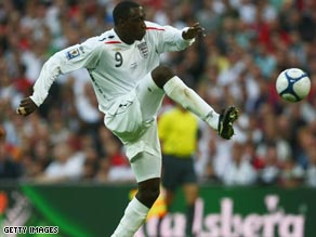 Heskey has been re-united with former manager Martin O'Neill after signing for Aston Villa.