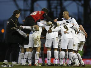 Swansea players celebrate their 2-0 upset victory over holders Portsmouth at Fratton Park.
