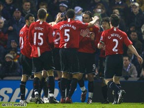 United players celebrate Dimitar Berbatov's opening goal in the 5-0 thrashing of West Bromwich Albion.