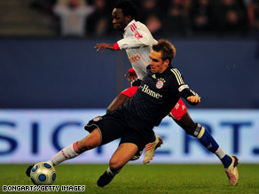 Jonathan Pitroipa of Hamburg, top, gets challenged by Philipp Lahm of Bayern in the Bundesliga match Friday.