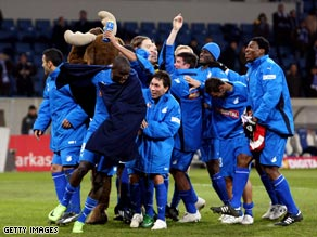 Hoffenheim players celebrate victory in their new stadium to go back on top.