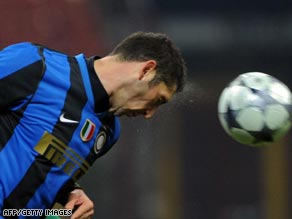 Marco Materazzi heads the ball in a Champions League  match in November 2008.