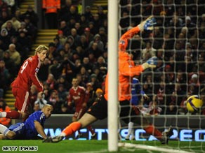 Torres heads past Petr Cech to put Liverpool 1-0 ahead at Anfield.