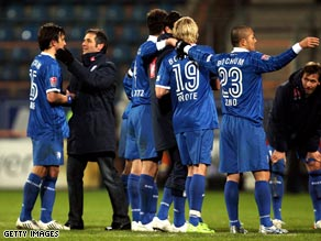Bochum players celebrate a vital victory over Karlsruhe.