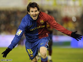 Messi celebrates his second and winning goal at Racing Santander.