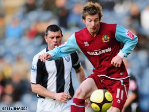 Winger Wade Elliott opened the scoring as Burnley reached the FA Cup fifth round with a win over WBA.