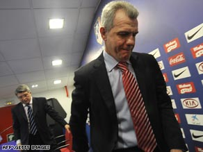 Mexican Javier Aguirre leaves his farewell Atletico media briefing followed by club president Enrique Cerezo.