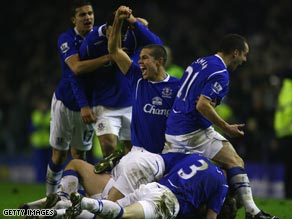 Teenager substitute Gosling is mobbed by Everton team-mates after knocking Liverpool out of the FA Cup.