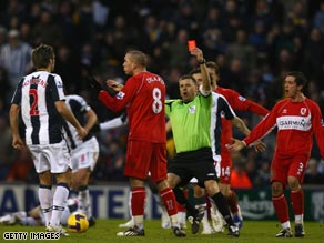 Referee Mark Halsey shows Didier Digard the red card in the January 17 game.