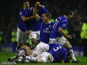 Everton players celebrate Dan Gosling's FA Cup winner against Liverpool.