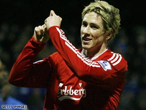 Fernando Torres celebrates his last-gasp winner as Liverpool return to the top of the Premier League table.
