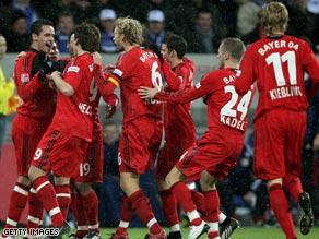 Leverkusen players celebrate Patrick Helmes (left) scoring the opening goal at Hoffenheim.