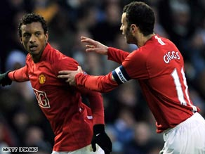 Nani (left) celebrates with Ryan Giggs after scoring the opening goal against Derby on Sunday.