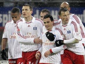 Hamburg celebrate Piotr Trochowski's opening goal in their 2-0 victory over Arminia Bielefeld.