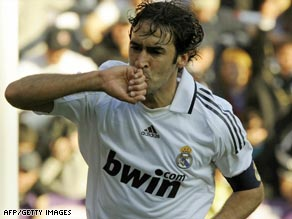 Raul celebrates in familiar style after breaking Di Stefano's Real Madrid record against Sporting Gijon.
