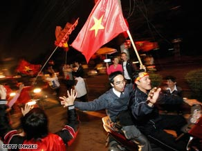 Celebration time: Five people were killed on Vietnamese roads as football joy got out of control.