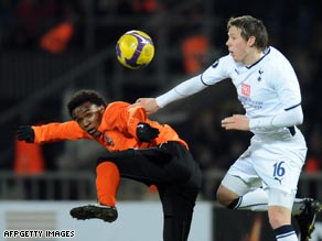 Donetsk midfielder Willian (left) challenges Chris Gunter for the ball as Donetsk defeated Tottenham 2-0.
