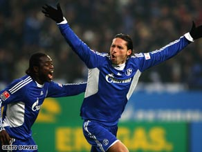 Kevin Kuranyi (right) celebrates opening the scoring for Schalke against rivals Dortmund.