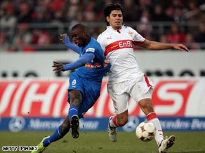 Ba (left) scores one of his goals as Hoffenheim went back to the top of the Bundesliga table.