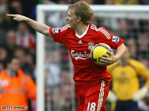 Dirk Kuyt rescued a draw for Liverpool on Sunday, but they now trail Manchester United by seven points.