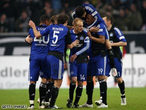 Hamburg celebrate Marcell Jansen's winning goal as they moved two points clear at the top of the Bundesliga.