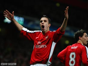 Van Persie celebrates his successful penalty in Arsenal's 1-0 win over Roma.