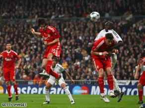 Benayoun (15) heads home the only goal as Liverpool claimed a superb 1-0 victory at the Bernabeu.