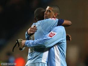 Coventry goal hero Best hugs captain Clinton Morrison at the end of the Blackburn tie.