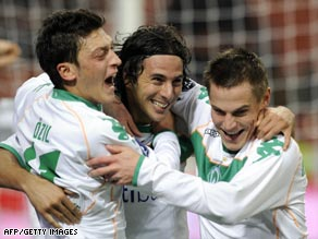 Pizarro (center) celebrates after his equalizing goal dumped AC Milan out of the UEFA Cup.
