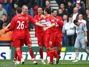 Middlesbrough players celebrate their opening goal at the Riverside against Liverpool.
