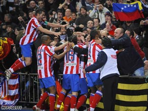 Atletico players celebrate Aguero's winning goal in the Vicente Calderon stadium.