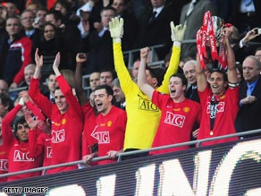 Rio Ferdinand (far right) lifts the trophy at Wembley after the penalty shootout win.