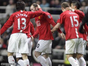 Wayne Rooney (center) is congratulated after scoring Manchester United's equalizing goal at Newcastle.