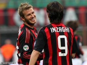 David Beckham congratulates hat-trick hero Filippo Inzaghi as the San Siro enjoys a double celebration.