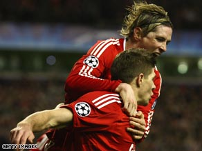 Torres, top, and Gerrard did the damage as Liverpool destroyed their rivals to reach the last eight in Europe.
