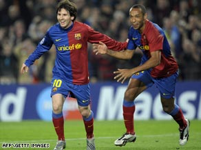 Lionel Messi, left, and Thierry Henry celebrate as Barcelona reach the last eight of the Champions League.
