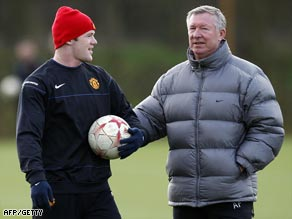Rooney (left) and Ferguson pictured at United's Carrington training ground.