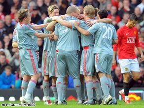 Liverpool celebrate Fabio Aurelio's superb free-kick as they crushed Manchester United 4-1 at Old Trafford.