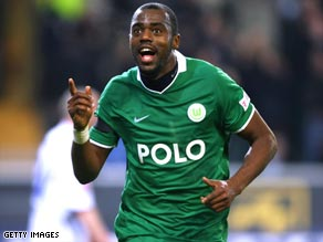 Grafite celebrates his hat-trick as Wolfsburg put themselves right into the Bundesliga title race.