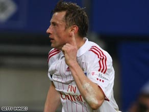 Ivica Olic celebrates his opening goal for Hamburg as they remain in touch near the top of the Bundesliga.