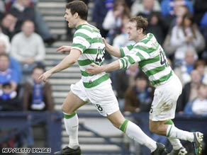 Darren O'Dea (left) peels away after scoring the opening goal in Celtic's 2-0 victory over Rangers.