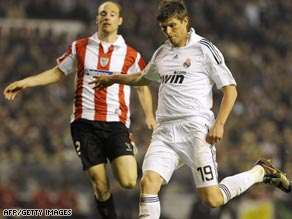 Klass-Jan Huntelaar (right) scored twice as Real Madrid hit five in an action-packed match against Bilbao.