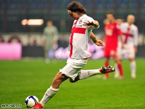 Ibrahimovic powers home a 30-meter free-kick in stoppage time at the San Siro.