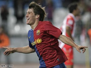 Bojan wheels away in delight after scoring in Barcelona's victory over Almeria.