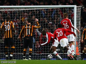 Williams Gallas (No.10) scores the winning goal as Arsenal sealed a semifinal showdown with Chelsea.