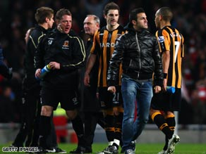 Fabregas (black jacket) has been accused by Hull of spitting at the feet of Brian Horton (third left).